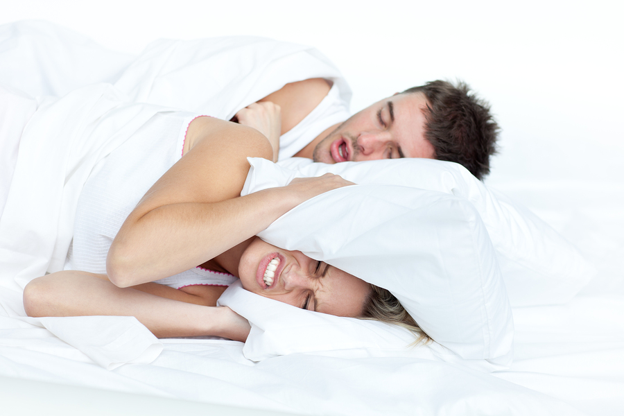 bigstock-Couple-In-Bed-While-The-Woman--9476543