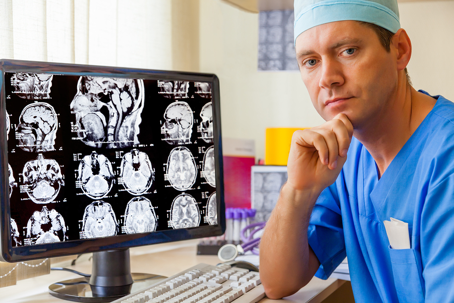 bigstock-Experienced-doctor-with-an-MRI-45421879