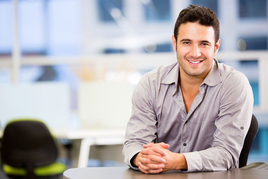 bigstock-Handsome-business-man-smiling--42359704