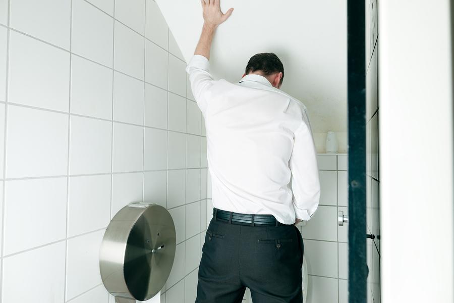 bigstock-Man-peeing-in-toilet-38541886