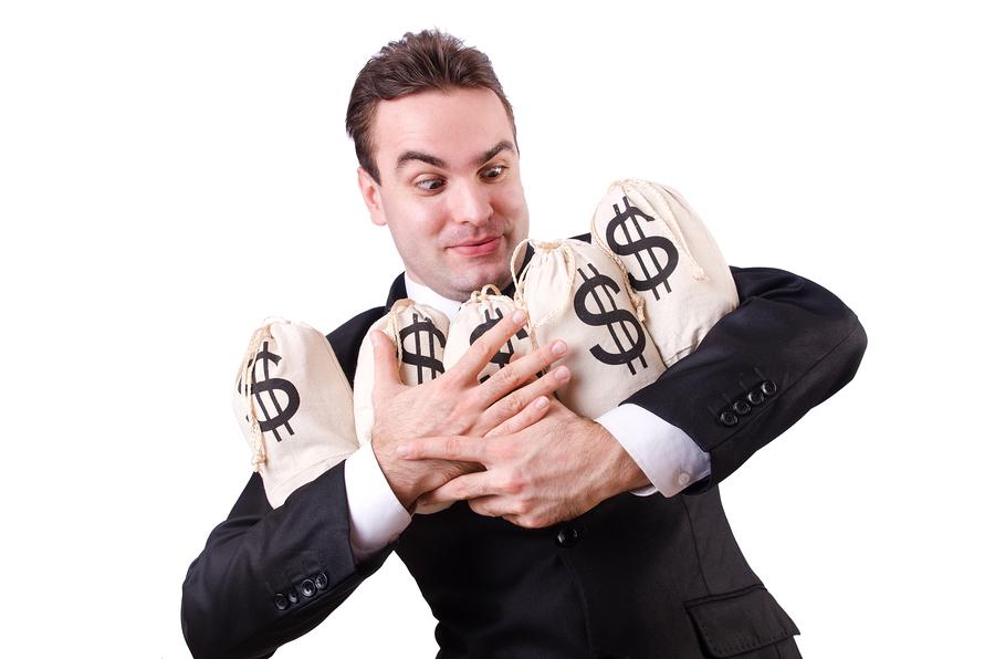bigstock-Man-with-money-sacks-on-white-45676828