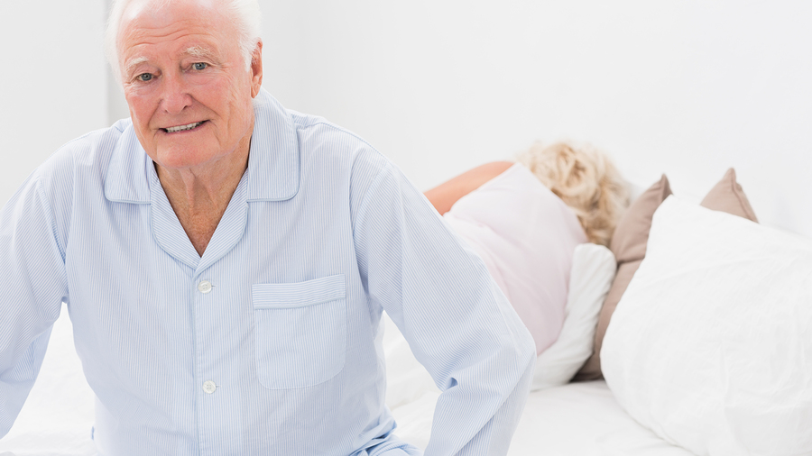 bigstock-Old-man-sitting-while-woman-sl-40891690