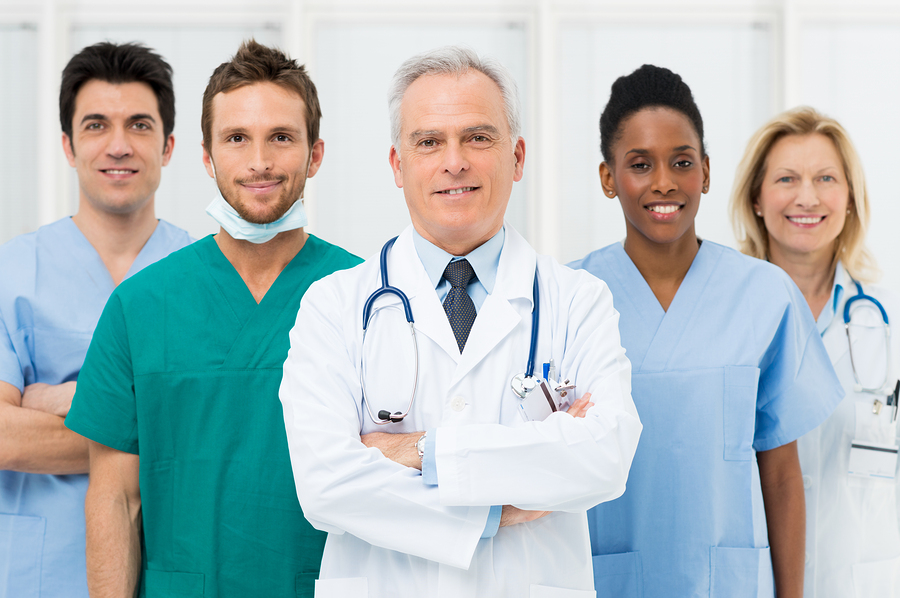 bigstock-Smiling-team-of-doctors-and-nu-45884800